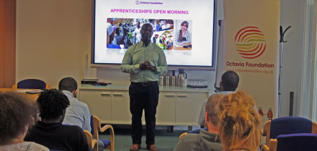 Wray bennett greets attendees at the apprenticeship open morning homepage listing